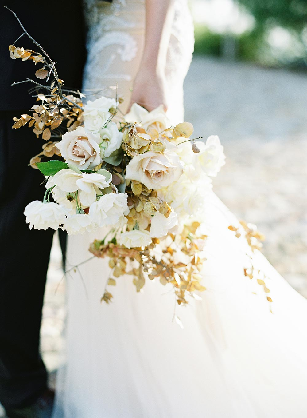strapless beaded wedding dress with organic cream bridal bouquet