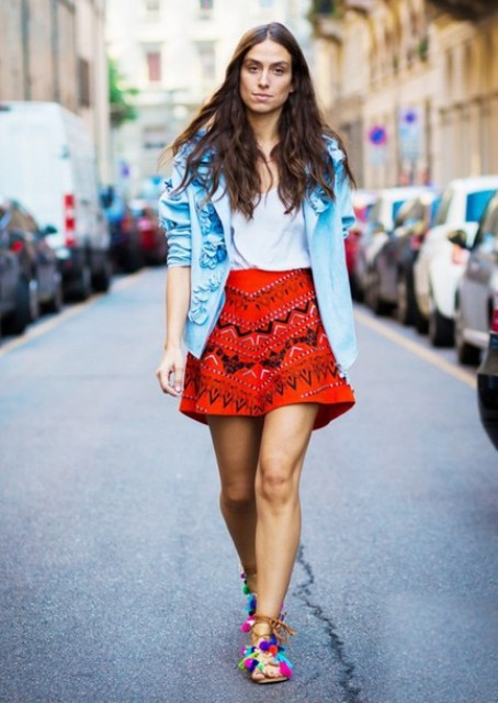 With white top, blue jacket and red printed skirt