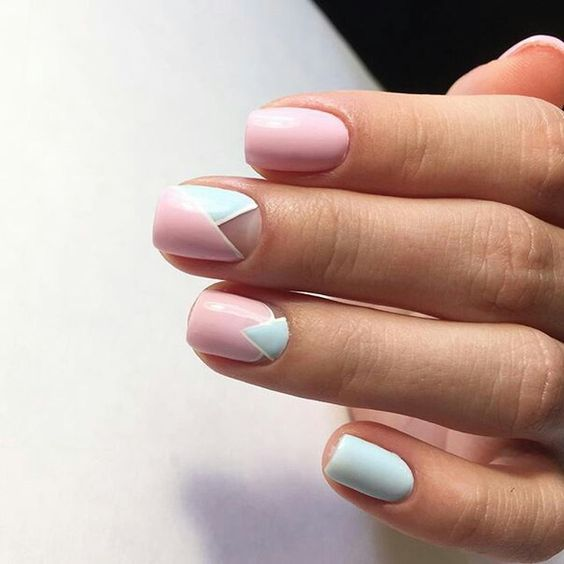 light blue and light pink geometric nails with sme negative space for a colorful summer touch