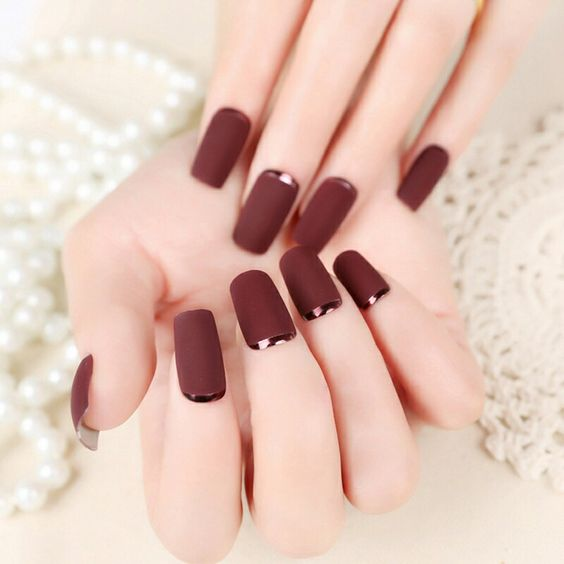 matte burgundy nails with dark copper crescent moon accents