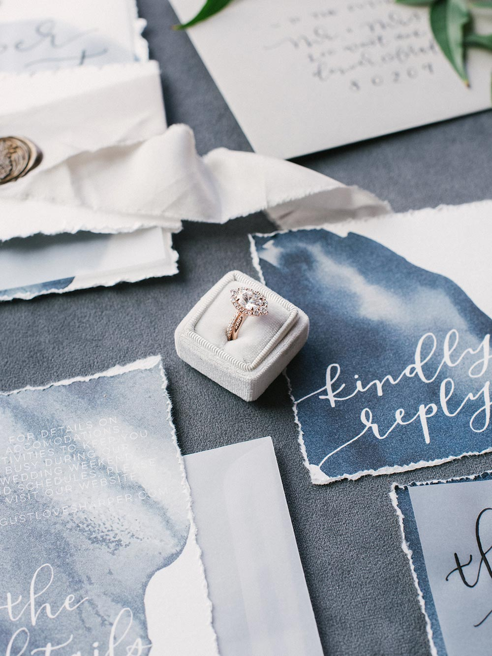 moody blue wedding invitations and pear shaped engagement ring