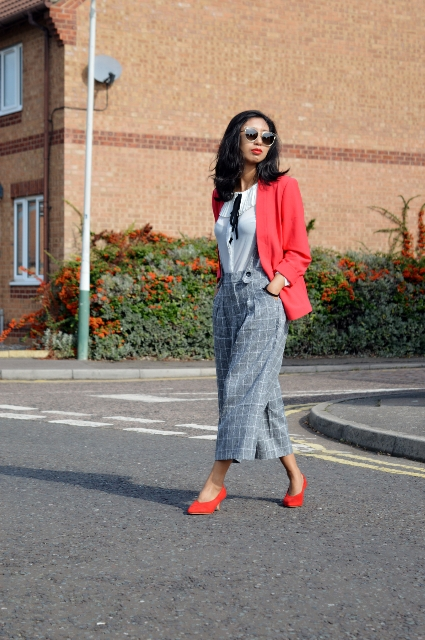 With white blouse, red blazer and red shoes