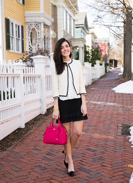 With white shirt, black mini skirt, black shoes and red bag