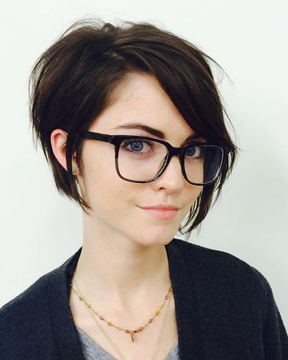 a longer pixie haircut with bangs looks very cute and textural