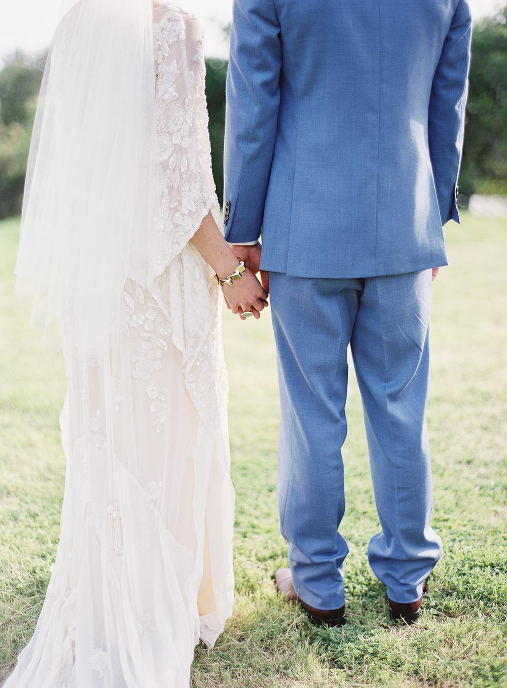 handbeaded caftan wedding dress and blue groom suit