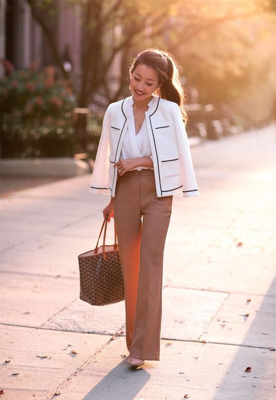 camel pants, a white shirt, a black and white blazer for a classic feel