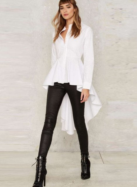 With black leggings and lace up heeled boots