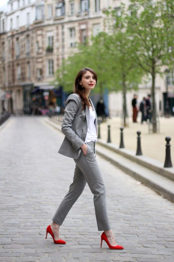 a grey suit, a white top and red pumps for a colorful touch