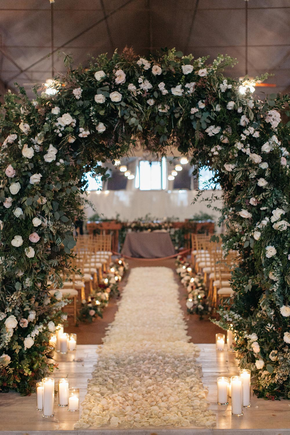 lush greenery wedding arbor