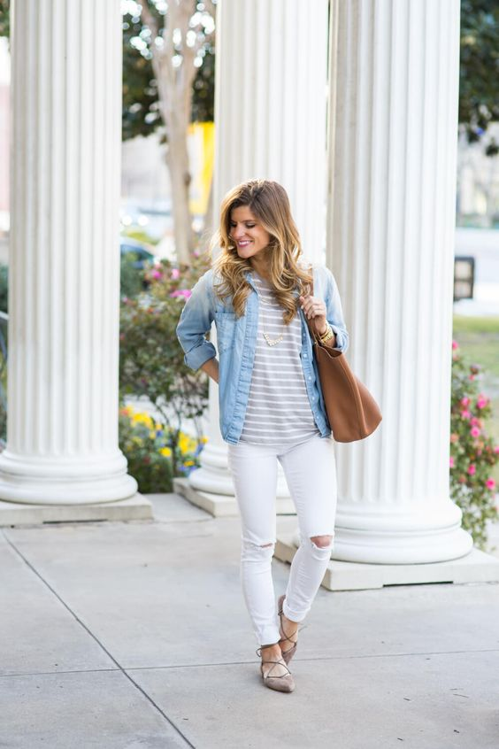 ripped white jeans, a striped tee, a chambray shirt, grey lace up flats and a large tote