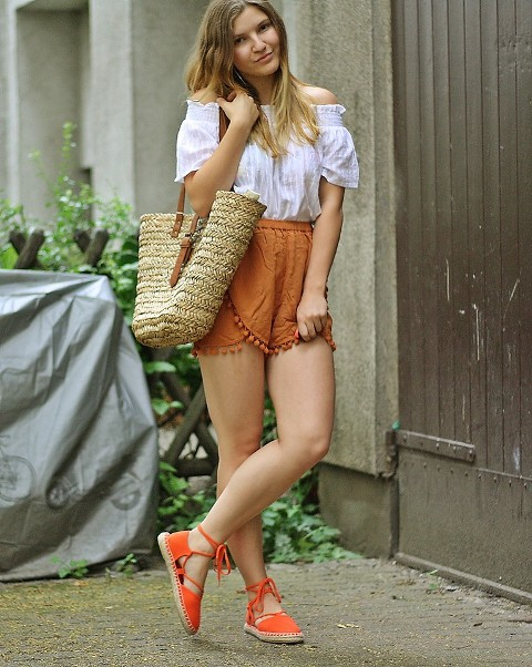 With off the shoulder blouse, orange lace up flats and straw tote