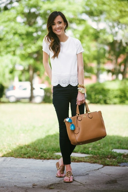 With black pants, brown tote and flat sandals