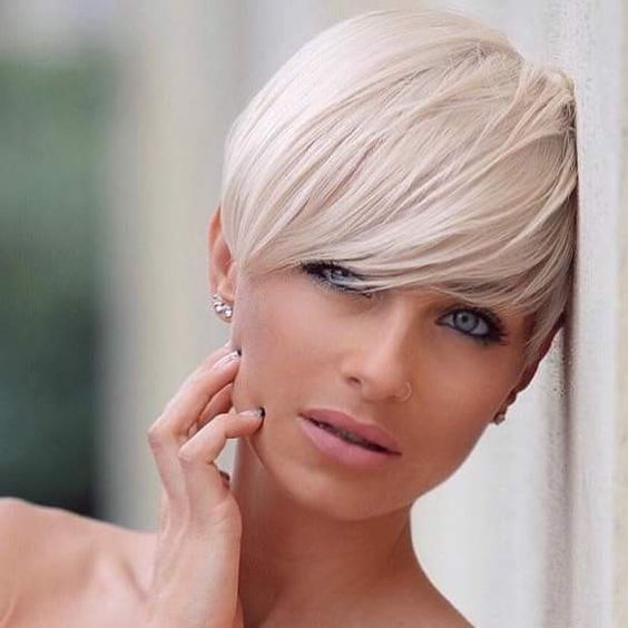 style your fringe on a longer pixie haircut to look softer and more feminine