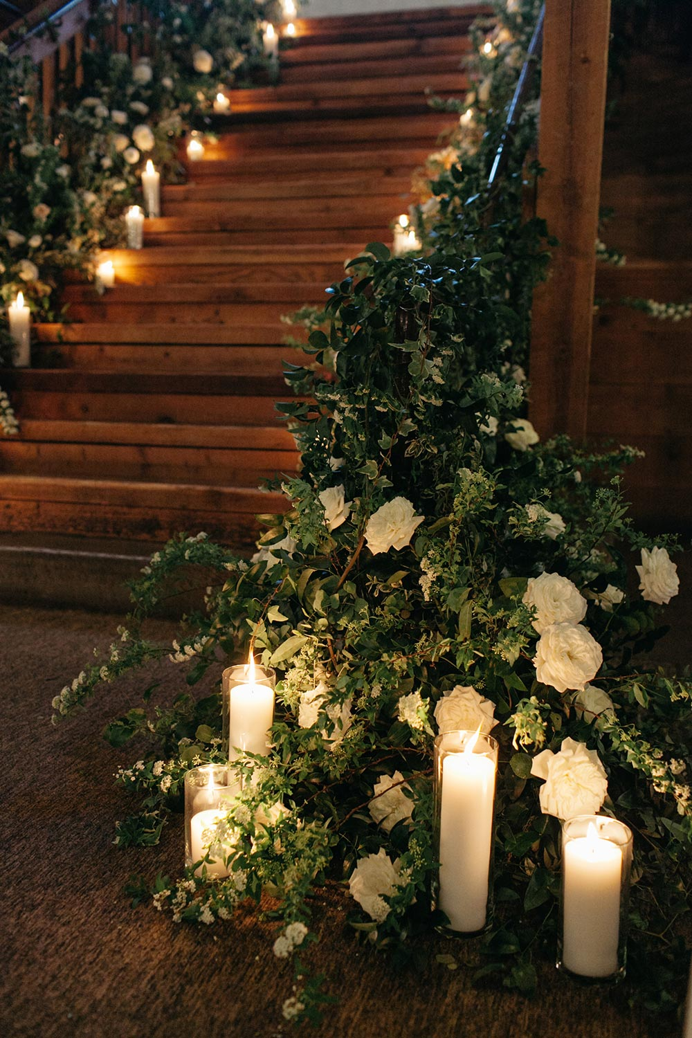 lush greenery wedding staircase with candles