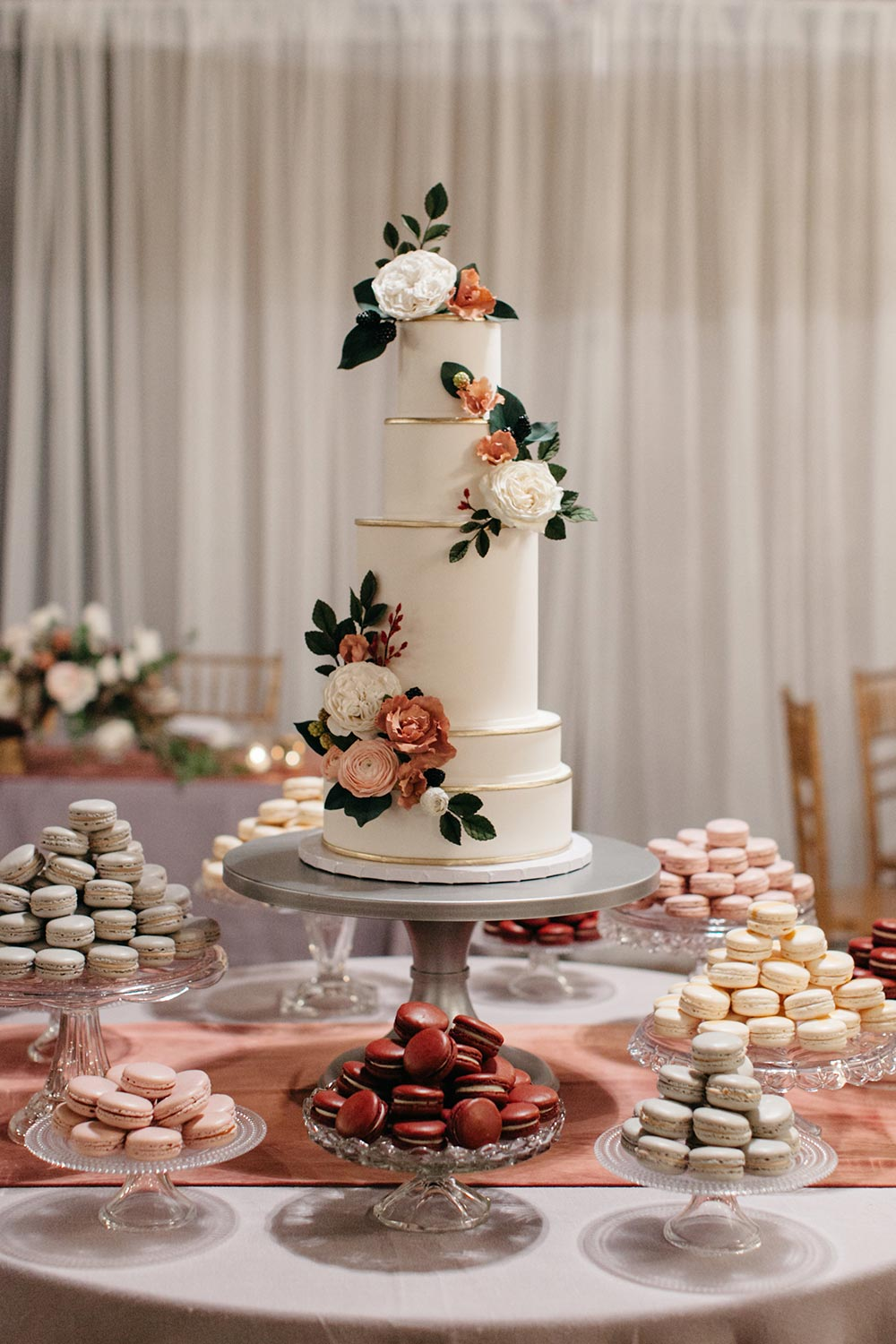 sugar flower wedding cake with citrus and pink colors