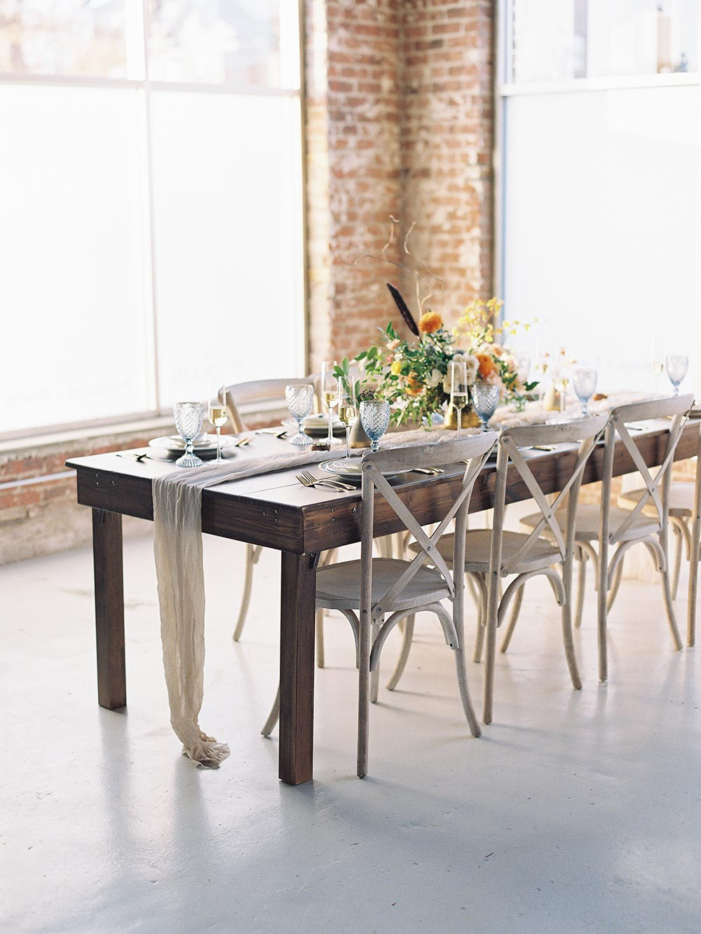 bright eclectic wedding tablescape with cross back chairs