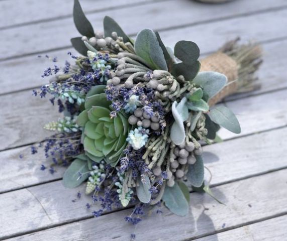 a chic pale wedding bouquet with lavender, berries and a succulent in the middle