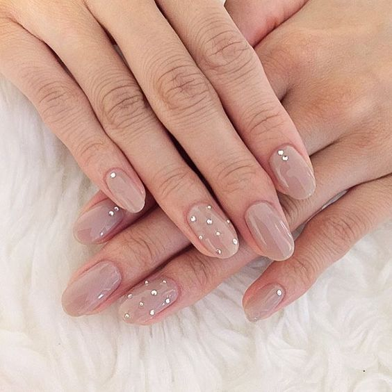 nude nails with little rhinestones look very cute and glam and will fit many bridal styles