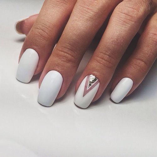 matte white nails and a single accent nail with silver sequins for a super elegant yet minimalist look