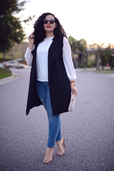 blue skinnies, a white shirt, nude shoes, a clutch and a long black vest for a business casual look