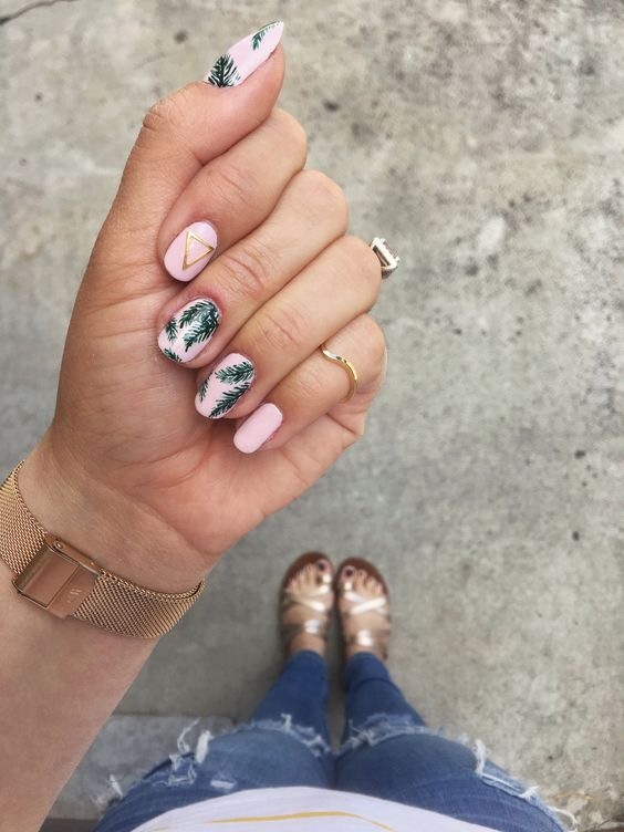pink nails with tropical leaf prints and metallic geometric touches for a tropical or beanch bride