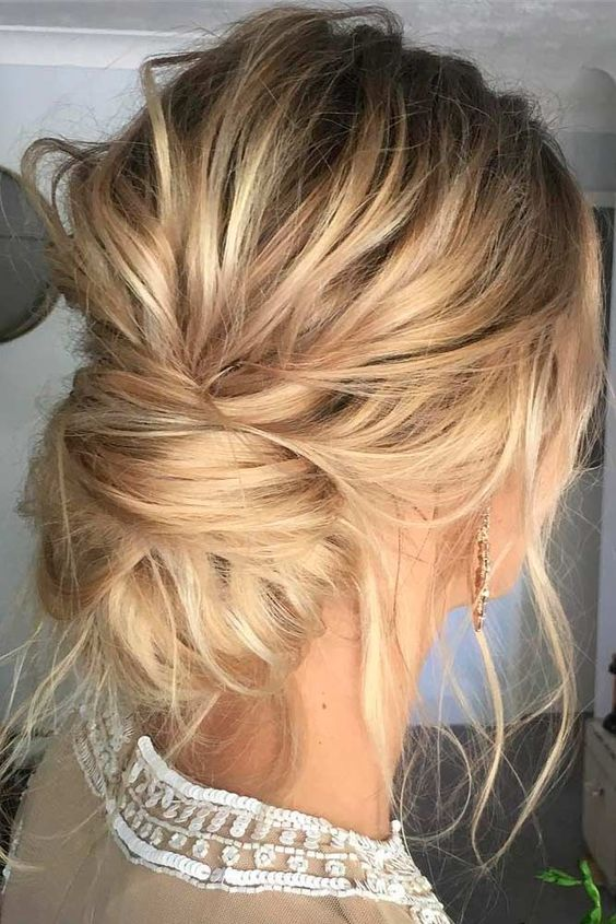 a very messy low bun, locks down and a messy volume on top will fit both long and medium hair