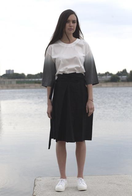 With black skirt and white sneakers