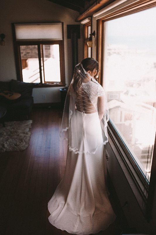 She was rocking a fitting wedding dress with a sheer lace illusion bodice and a lace up back plus a small train