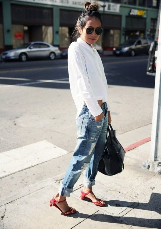 a white shirt, blue ripped boyfriends, a black bag and red retro sandals for a comfy casual look