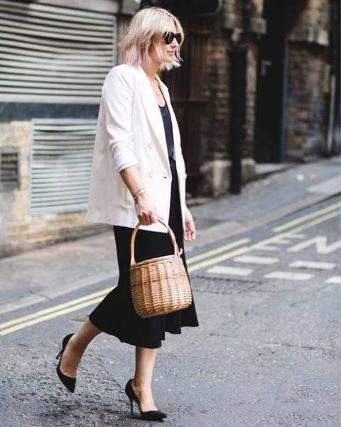 With top, black skirt, white loose blazer and black pumps