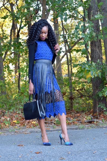 With blue lace midi dress, pumps and leather bag
