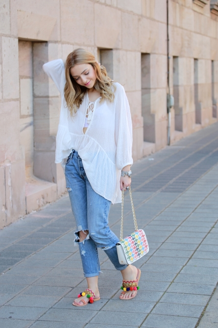 With white loose blouse, jeans and printed bag