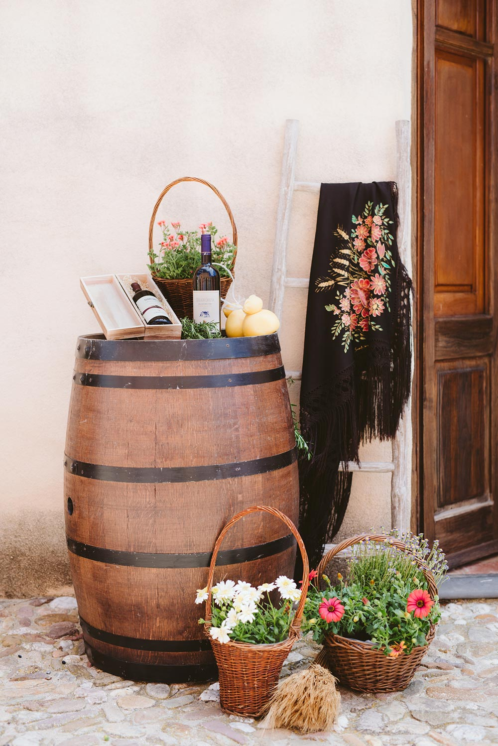 rustic chic Italian wedding decor with handpainted shawl