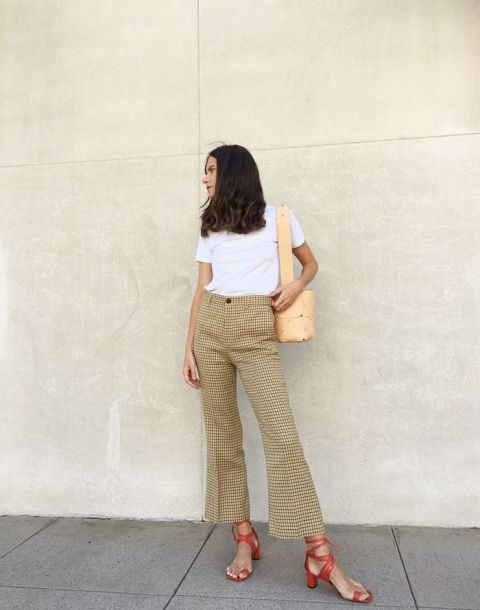 With white shirt, checked flare trousers and beige bag