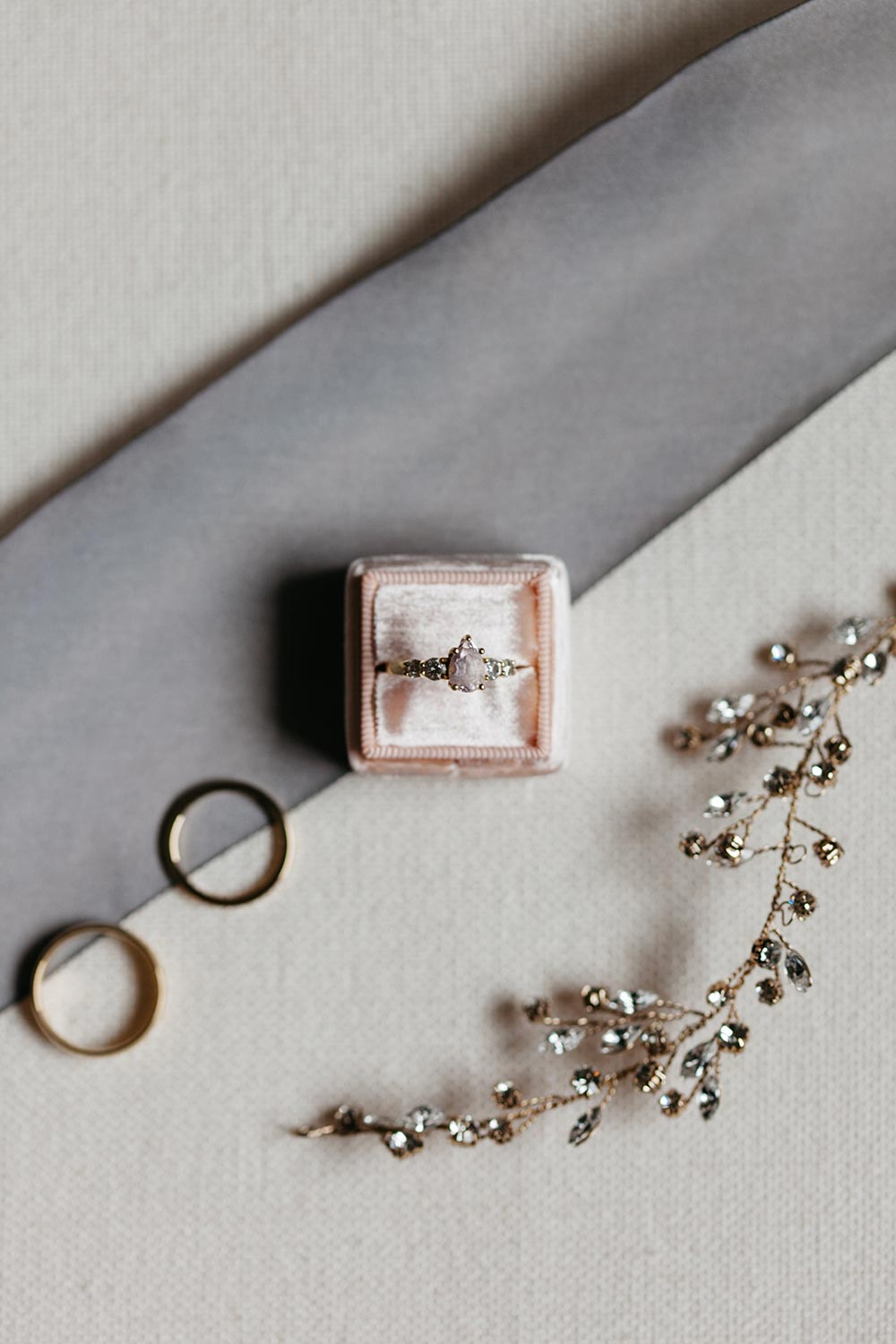 pear shaped engagement ring with pink velvet ring box