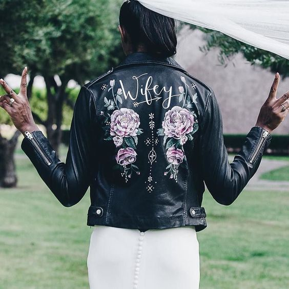 a hand painted leather jacket in black is a gorgeous feminine statement