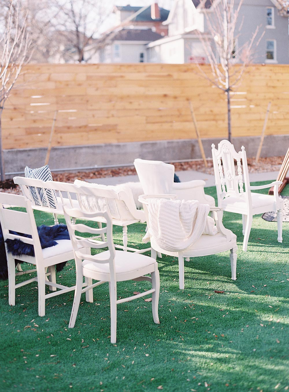 mismatched white ceremony chairs