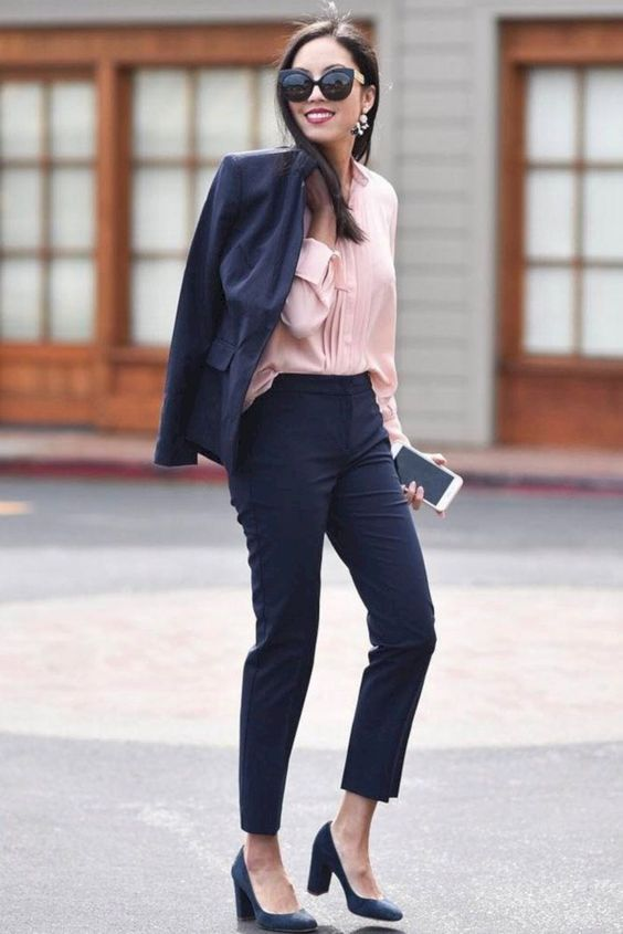 a navy suit with cropped pants, a blush blouse, navy shoes for a bold look