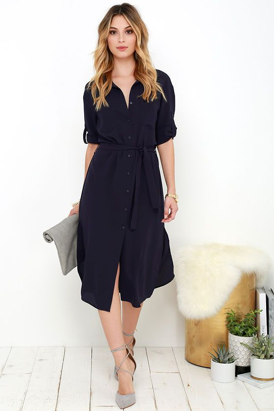 a navy midi shirtdress, grey suede lace up heels and a matching clutch for work