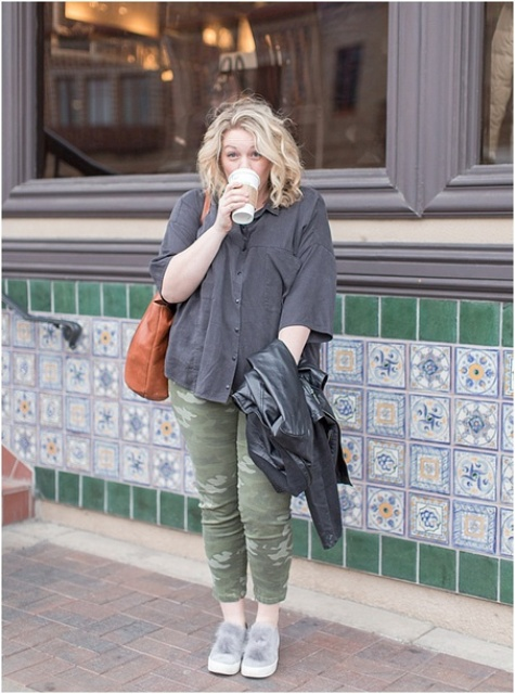 With gray button down shirt, skinny pants, brown tote and black leather jacket