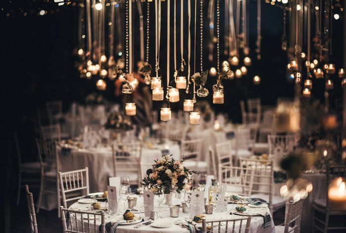 The wedding reception space was illuminated with small candle holders and crystals