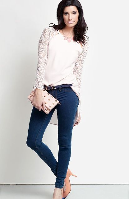 With skinny jeans, pale pink shoes, small clutch and black belt