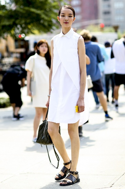 With white dress and black leather bag