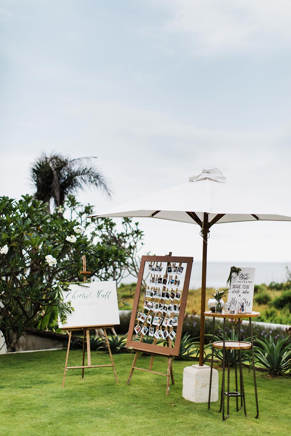 wedding welcome station with photo guest book and modern calligraphy signage