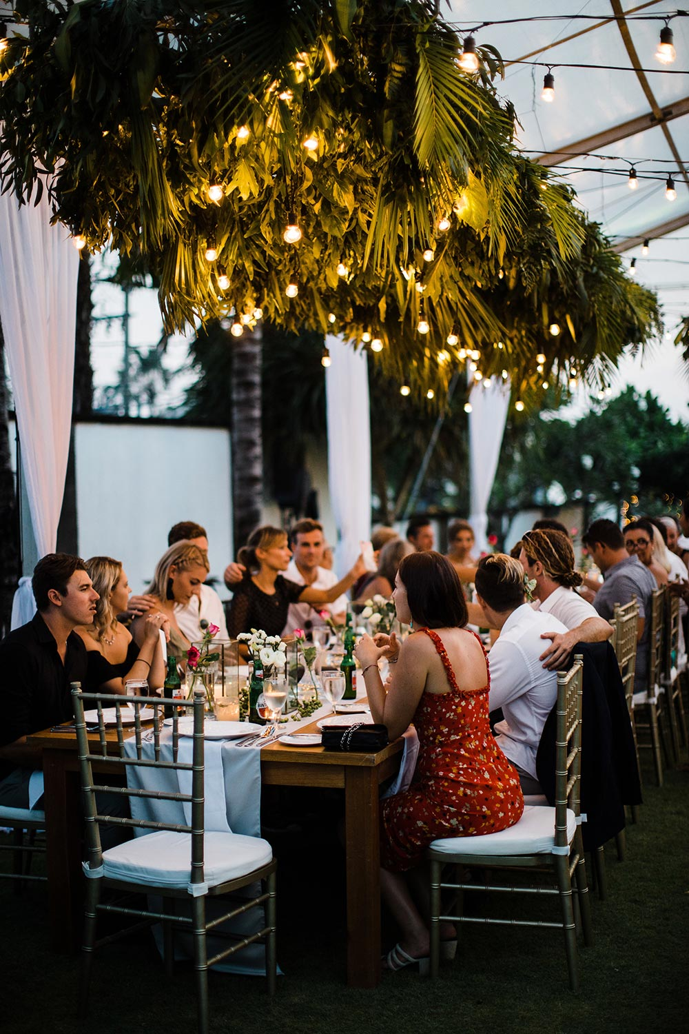 palm frond chandelier tropical wedding reception