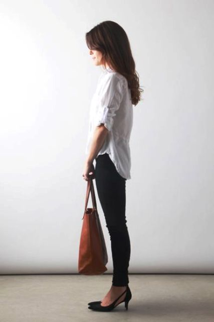 black skinnies, a white shirt and a tan bag plus black kitten heels for a chic work look