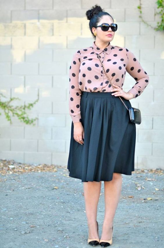 a black full knee skirt, a dusty pink polka dot shirt, blush and black heels for a girlish feel