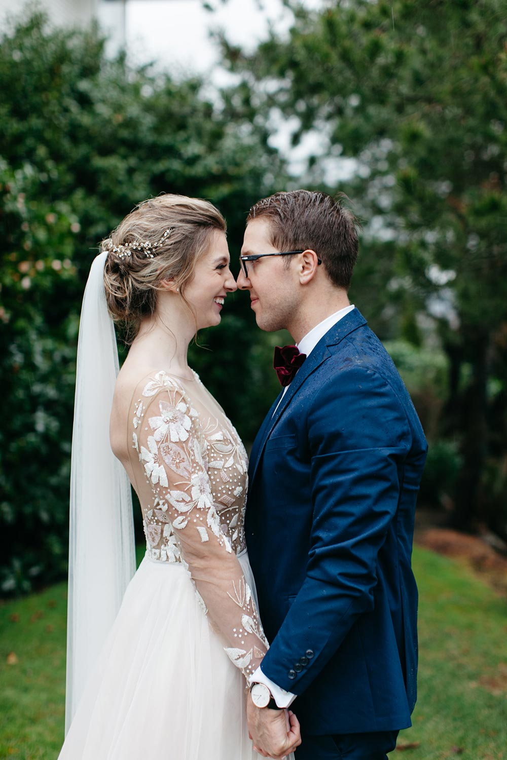 Hayley paige long sleeve wedding dress and navy groom suit