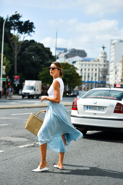With white top, light blue midi skirt and white shoes