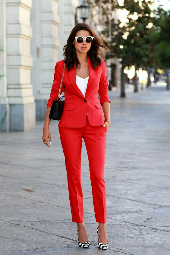 add color to your work wardrobe with a red pantsuit, a white top, printed shoes and a black bag